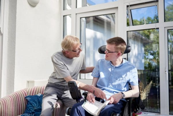 carer and man in wheelchair
