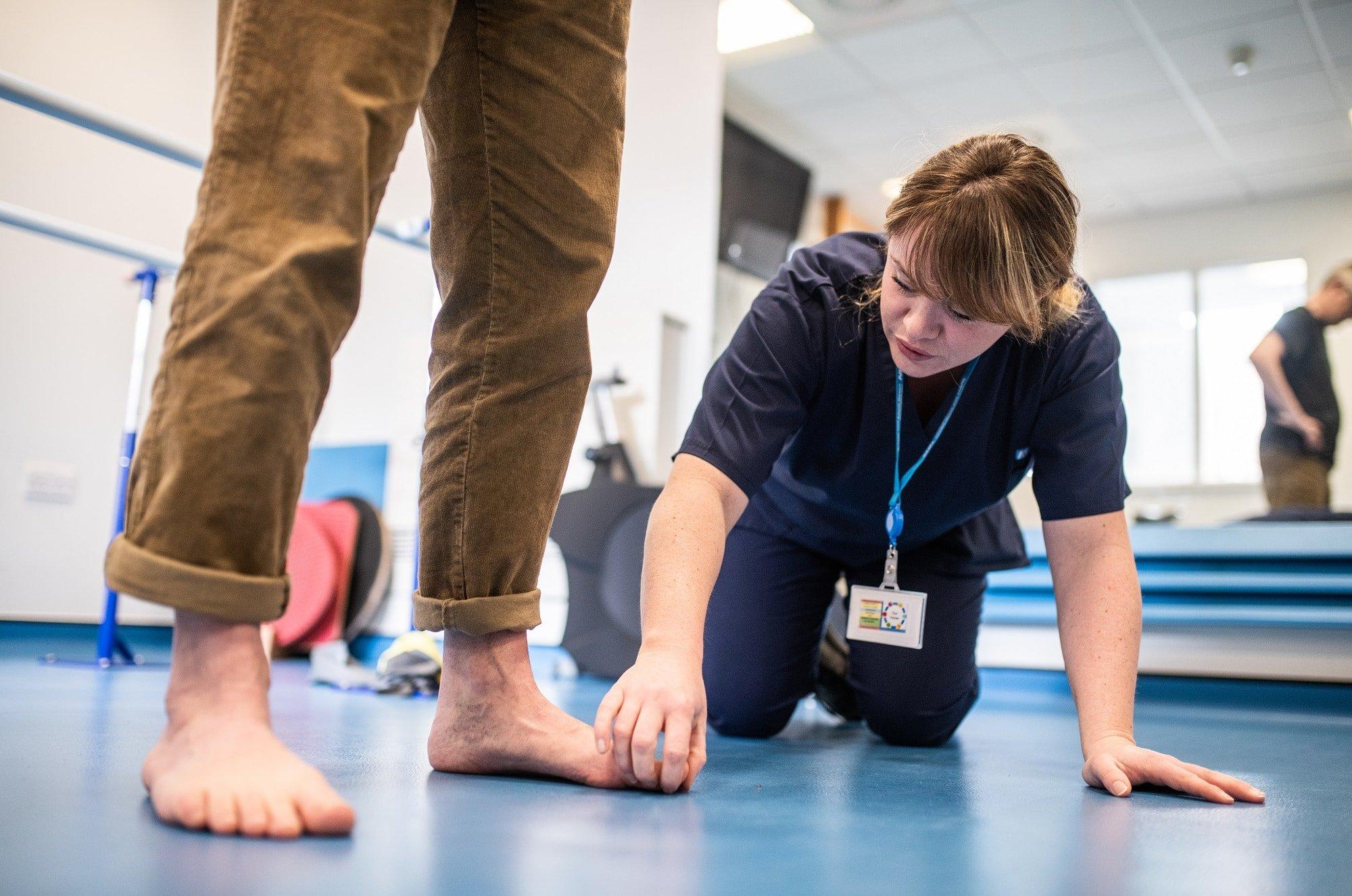 Podiatrist checking patients feet