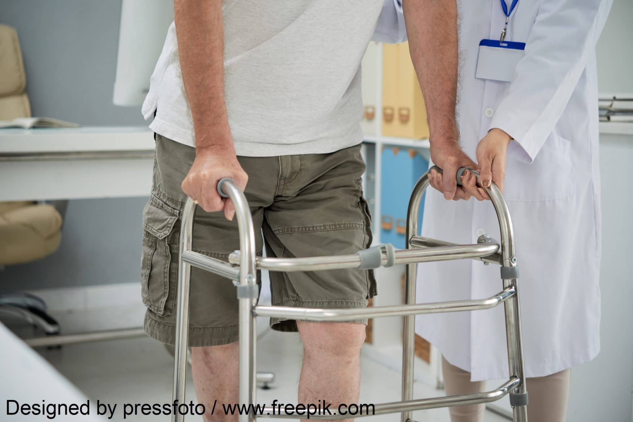 Man making first steps with help of walker after rehabilitation therapy