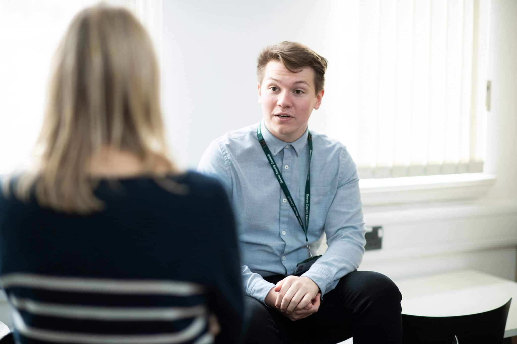 Social worker talking to a colleague