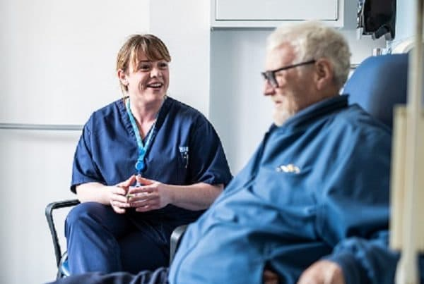Louise the podiatrist sat talking to a patient