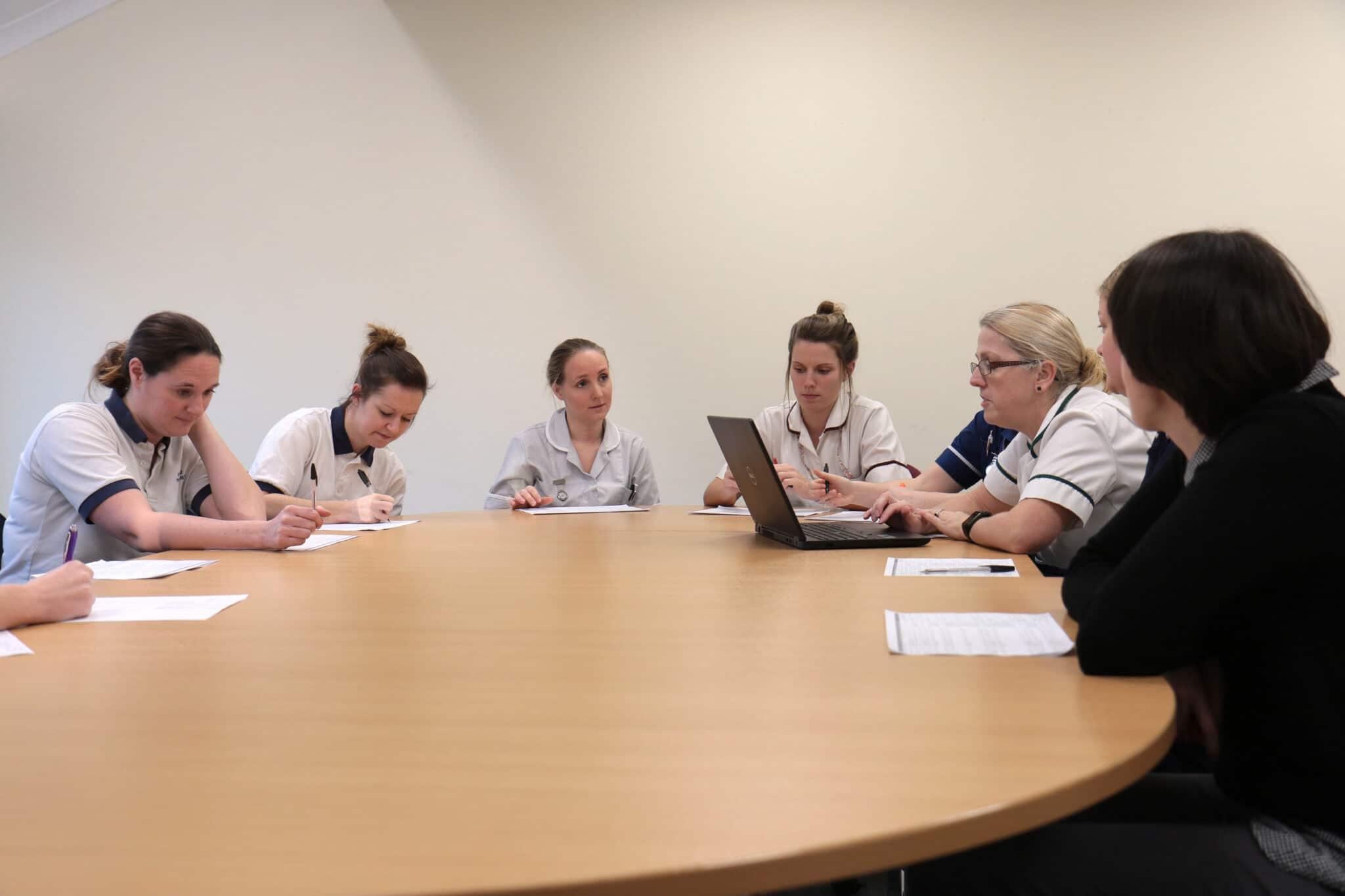Nurses around a table